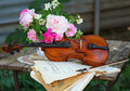 Antique violin, notes and spring bouquet Stock Photos