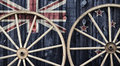 Antique Wagon Wheels with New Zealand flag Royalty Free Stock Photo