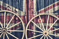 Antique Wagon Wheels with UK flag Royalty Free Stock Photo