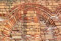 Antique wall, details of brickwork of an ancient Byzantine church, horizontal grunge background Royalty Free Stock Photo