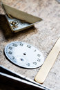 Antique watch quadrant and clockworks on a repair table tools wooden in watchmaker shop Royalty Free Stock Photo