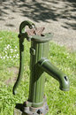 Antique water pump tap in urban park Royalty Free Stock Photo