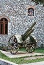 Historical Canon on Display, Kalavryta Church, Peloponnese, Greece Royalty Free Stock Photo