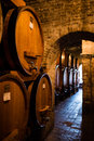 Antique wine cellar with row of big barrels Royalty Free Stock Photo