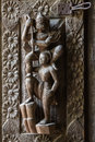 Antique wood carving in the form of deities Royalty Free Stock Photo