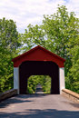 Antique Wood Covered Bridge on Quiet Country road Stock Photo