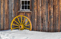 Antique Wood Old Yellow Wagon Wheel Snow Royalty Free Stock Photo