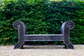 Antique wooden bench on pebble yard garden Stock Photos