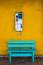 Antique wooden chair blue with cell wall with a yellow background. Royalty Free Stock Photo