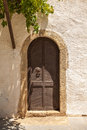 Antique wooden door with metal decor in monastery toplou crete greece Royalty Free Stock Photos