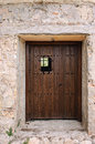 Antique wooden door old medieval style in southern europe Stock Photo
