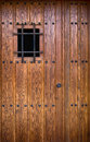 Antique wooden door old medieval style in southern europe Stock Photos