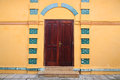 Antique wooden door and yellow wall Stock Photos