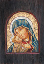 Antique wooden painting of virgin mary with baby jesus Royalty Free Stock Images