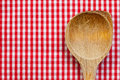Antique wooden spoon for cooking with red white background Stock Photos