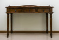 Antique wooden table old style with white wall Royalty Free Stock Photos
