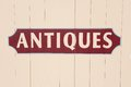 Antiques antique sign painted on a wooden surface Royalty Free Stock Photography