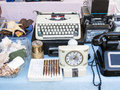 Antiques athens flea market including typewriter clock cassette and telephone greece Stock Photos
