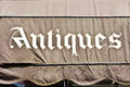 Antiques part of the sign for an store Royalty Free Stock Photography