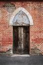 Antiquities door on damage wall Stock Images