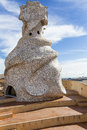 Antoni gaudì s sculpture la pedrera sinuous covered by a mosaic on the rooftop of in barcellona Stock Photo