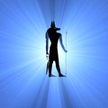 Anubis egyptian symbol light flare god of afterlife protector of tomb and dead with dog s head holding an ankh and staff which Stock Image