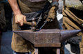 Anvil blacksmith working at the forge with Royalty Free Stock Images