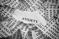 Anxiety torn pieces of paper with the word concept image black and white close up Royalty Free Stock Image