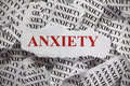 Anxiety torn pieces of paper with the word concept image close up Royalty Free Stock Image