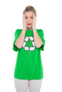 Anxious blonde activist wearing recycling tshirt posing on white background Royalty Free Stock Photography