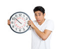 Anxious man closeup portrait of business funny student leader holding clock very stressed running out pressured by lack of time Royalty Free Stock Photo