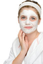 Anxious teenager girl applying face mask cleaning treatment cosmetics Stock Photo