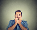 Anxious young man biting his nails fingers freaking out Royalty Free Stock Photo