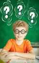 Any ideas portrait of happy schoolboy in eyeglasses looking at camera Royalty Free Stock Image