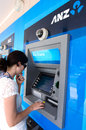Anz bank australia and new zealand banking group auckland sep young woman s use an atm machine on sep it s the largest in nz the Royalty Free Stock Photos