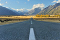 Aoraki mount cook straight empty highway leading into Royalty Free Stock Image