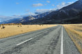 Aoraki mount cook straight empty highway leading into Royalty Free Stock Photography