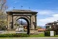 Aosta romanic arch on a blue cloudy sky Stock Photos