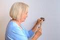 Apable elderly woman doing DIY Royalty Free Stock Photo