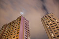 Apartment blocks from below with long exposure at night high Stock Photos