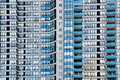 Apartment building density picture of multiple units close up showing blue balconies and cladding Royalty Free Stock Photo