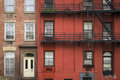 Apartment building manhattan new york city old with fire escapes Royalty Free Stock Images