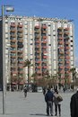 Apartment building on seafront at barceloneta barcelona catalonia spain with people walking and cycling promenade Stock Image