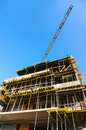 Apartment building under construction over blue sky Stock Image