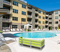 Apartment complex court exterior with swimming pool Stock Photos