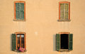 Apartment windows a view of on the side of an old worker s building in crespi d adda italy crespi d adda village unesco an old Royalty Free Stock Photography