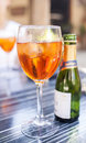 Aperol spritz glass with long drinks veneto sprizz with oranges on the table Stock Photo