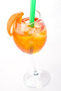 Aperol Spritz in a wine glass with ice cubes decorated with an orange slice on white background, summer cold drink isolated on whi
