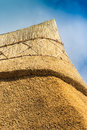 Apex of a freshly thatched cottage roof Royalty Free Stock Photo