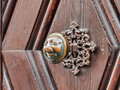 Apfelweibla vintage doorknob on antique door background famous knob with an old woman face from the tale of eta hoffmann in the Royalty Free Stock Photo